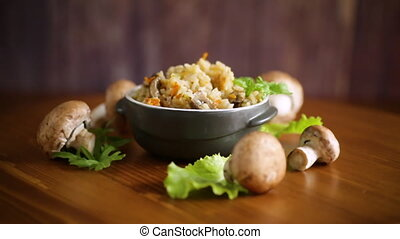 vegetarian cooked rice with mushrooms in a ceramic bowl on ...