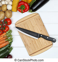 Vegetarian cooking cutting board preparing food with knife and vegetables