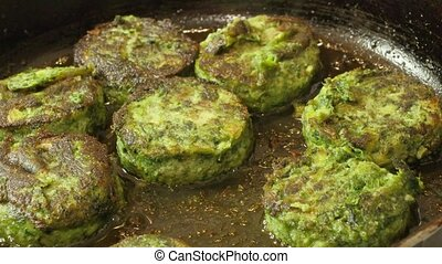 vegetarian cutlets made from green vegetables fried in a...