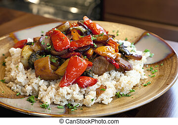 A healthy vegan dinner of brown rice and roasted vegetables