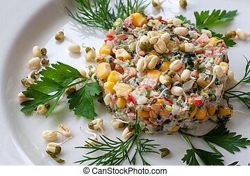 Vegetarian dish: a salad of broccoli, corn, seaweed, sweet pepper and sprouted seeds. Raw foods.
