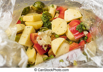 Vegetarian dish. Mixed vegetables in a bag for baking in an oven. A set of vitamins