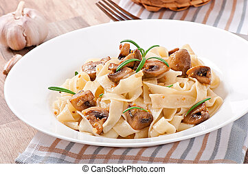 dish with tagliatelle and mushrooms - Vegetarian dish with ...