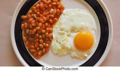 Vegetarian English breakfast with baked beans and fried egg