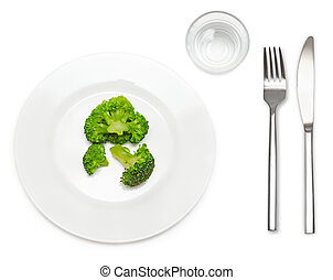 Vegetarian food - Boiled broccoli on white plate with glass...