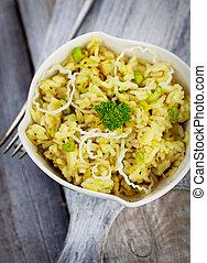 Vegetarian food. Leek risotto with garnish