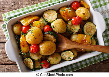 Vegetarian food: new potatoes baked with zucchini, peppers...