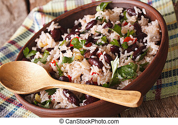 Vegetarian food: rice with red beans in a bowl close-up....
