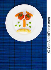 Vegetarian food - Tomato carrot peas and corn served on a ...