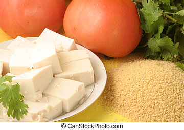 vegetarian food (tomato, tofu, parsley, and couscous)