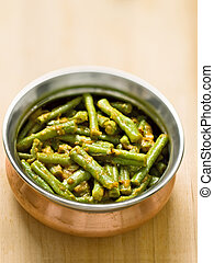 close up of a bowl of vegetarian indian long bean masala curry