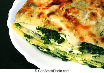 Vegetarian lasagna with ricotta cheese spinach filling