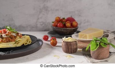 Vegetarian lentil Bolognese sauce penne pasta on a dark background. Healthy eating concept.