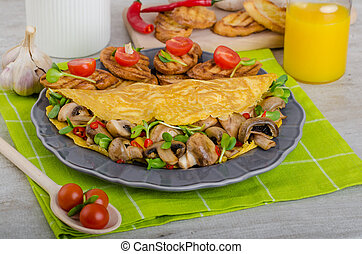 Vegetarian omelet, eat clean food, herbs, microgreens and mushrooms with chilli
