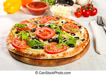 Vegetarian pizza on a wooden board