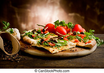 photo of delicious vegetarian pizza with arugula on wooden table