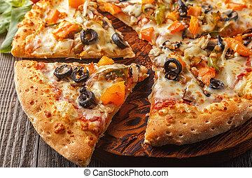 Vegetarian pizza with mozzarella cheese, tomatoes, champignons.