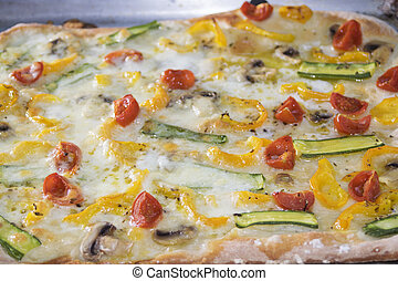 vegetarian pizza with tomatoes and zucchini
