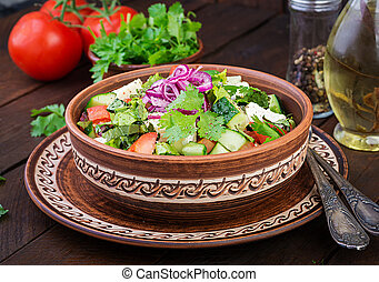 Vegetarian salad with cherry tomato, brie cheese, cucumber, ...