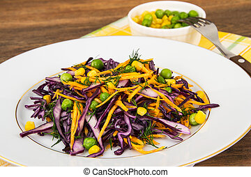 Vegetarian salad with corn, carrots and red cabbage