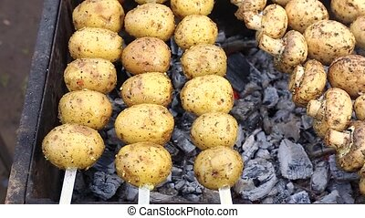 Vegetarian shish kebab from potatoes and mushrooms of...