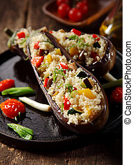 Vegetarian stuffed aubergine menu on a rustic wooden background
