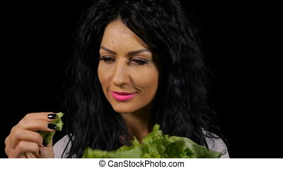 Vegetarian young woman healthy eating fresh green salad