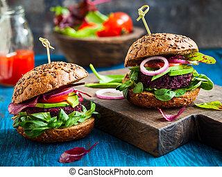 Veggie beet and quinoa burger with avocado