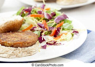Veggie Burger on Bun - Veggie burger pattie on a bun with a...