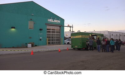 Veggie Food Truck With Warehouse - The hustle and bustle of...