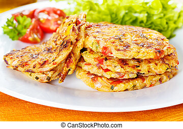 fresh homemade vegetable fritters with zucchini, paprika and corn