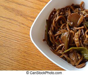 veggie lo mein at asian restaurant