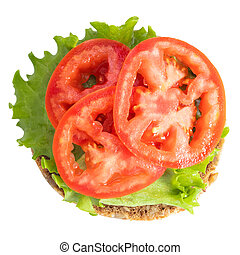 veggie sandwich with lettuce and tomatoes isolated on a white background. Top view