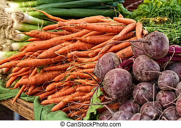 Veggies at the farmer's market - Carrots, beets, and onions...