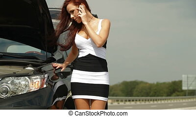 Vehicle Breakdown - Woman having car troubles on the road,...