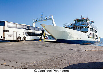 Vehicle, bus is entering to ferryboat's deck, boarding cargo