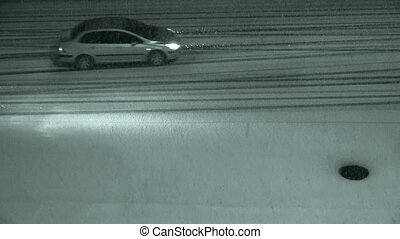 Vehicle car traveling on road in snow at night, traffic, motorcycle.