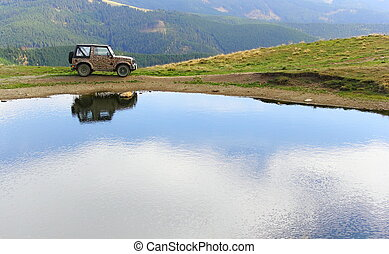 vehicle for extreme terrain near a lake - vehicle for...
