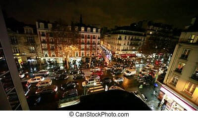 Vehicle jam on some crossroad in old Paris at night