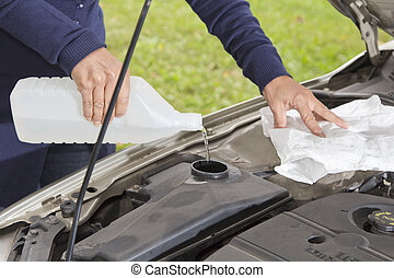 Filling the windshield washer fluid