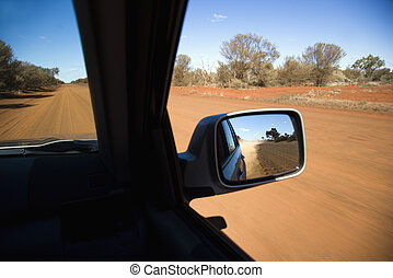Vehicle on dirt road