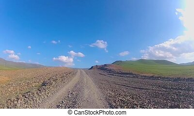 Vehicle point-of-view driving on a dirt road