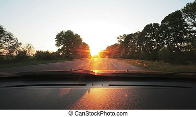 Vehicle point-of-view driving on road. Look through windscreen
