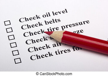 A checklist for vehicle safety with a red pencil.