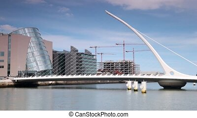 Vehicle traffic on contemporary Samuel Beckett Bridge in Dublin