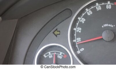 Vehicle turn signal indicator. car dashboard with blinking green arrow