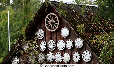Vehicle wheel trims parts on the wall of the cabin