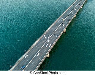 Vehicles on bridge over water