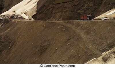 Vehicles travelling on a Leh-Ladakh road