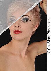 Veiled blonde. - Veiled look.